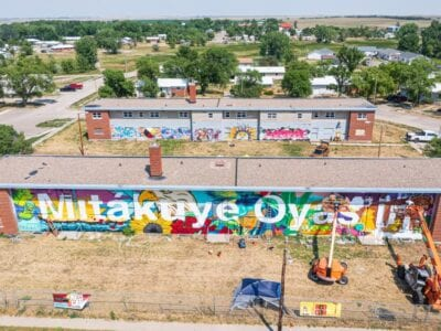 """New mural welcomes visitors to Eagle Butte and proclaims: Mitákuye Oyášiŋ, """"We are all related."""""""